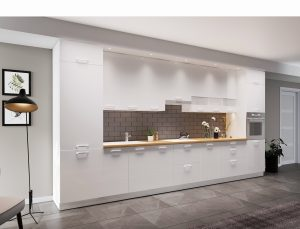 W systemie KAMmono można zdecydować się na uchwyty w tym samym kolorze, albo przełamać biel frontów uchwytami w kolorze czarnym. W obu wersjach kuchnia prezentuje się szykownie. Fot. KAM