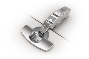 Niezwykłe możliwości za-mknięte w estetycznej opra-wie ? nowy zawias Sensys do cienkich frontów pozwala projektować fronty o grubo-ści zaledwie 10 mm. To za-sługa nowatorskiej konstruk-cji zawiasu, który wymaga nawiercenia zaledwie 8 mm. Fot. Hettich