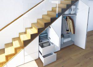 Gładka powierzchnia frontów pod schodami na pierwszy rzut oka nie zdradza, że kryje się za nimi całkiem pojemna szafka. Taki efekt można osiągnąć stosując systemy meblowe umożliwiające otwieranie frontów bez uchwytów, jak WingLine L z opcją Push to move. Fot. Hettich