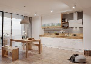 """Okno skutecznie doświetli wnętrze i może być mocnym atutem aranżacyjnym kuchni. Jeżeli jego wysokość uniemożliwia zaprojektowanie zabudowy meblowej, będzie doskonałym """"tłem"""" dla kącika jadalnianego. Fot. KAM"""