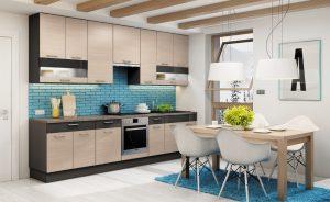 Alternatywą dla frontów w kolorze niebieskim, jeżeli te wydają się jednak zbyt odważne, są elementy dekoracyjne w tym kolorze. Cegiełka w morskim wybarwieniu mocno podkręca łagodną stylistykę frontów w dekorze jasnego drewna. Fot. KAM