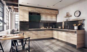 Dekor drewna dodaje kuchni przytulnego charakteru i wprowadza ciepłą atmosferę, czerń ? dynamizuje przestrzeń i nadaje zabudowie meblowej wyrazistego stylu. Jest nowocześnie, ale i ponadczasowo. Fot. KAM