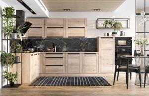 Nowoczesny, surowy charakter metalu w czarnym wybarwieniu doskonale komponuje się z ciepłym drewnem. Aranżacja inspirowana modnym stylem loftowym odświeża klasyczny wizerunek zabudowy meblowej i dynamizuje wnętrze. Fot. KAM